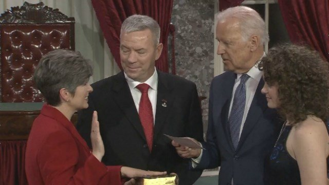 Joni Ernst takes part in a re-enactment swear-in ceremony Tuesday afternoon