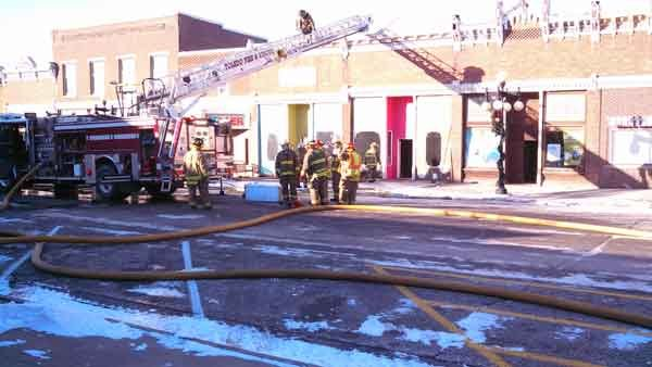 Smoke pouring from roof of flower shop in downtown Traer. (Eric Lightner, KWWL)