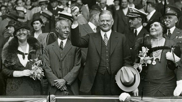 1931- President Herbert Hoover throwing out the first ball of the World Series game played in Philadelphia between the Cardinals and the Athletics