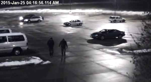 A still from one of the surveillance videos showing two suspects entering Western Dubuque High School the night a faucet was left on, flooding several classrooms.