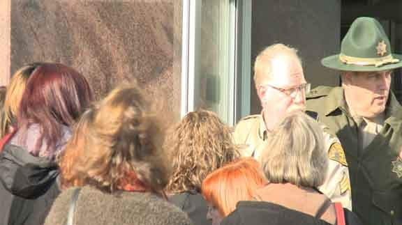 The Black Hawk County Sheriff's deputies let courthouse employees and visitors back into the courthouse Friday. (Marissa Hopper)