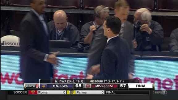 UNI men's basketball coach Ben Jacobson shakes hands after the Panthers' 68-57 win over Missouri State on Saturday.