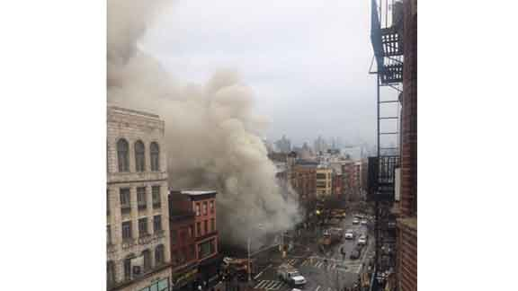 A building is seen after it collapses in New York City on Thursday, March 26. (User @Scott Westerfield/Twitter)