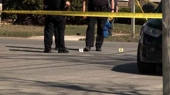 Waterloo Police add evidence markers to the intersection of Mulberry and Vinton streets April 2 in Waterloo. (Zach Grant, KWWL)