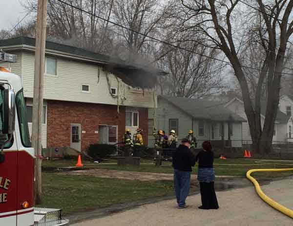Crews work to extinguish a duplex fire in Evansdale. Two children were rescued by construction workers. (Michael Crowe, KWWL)