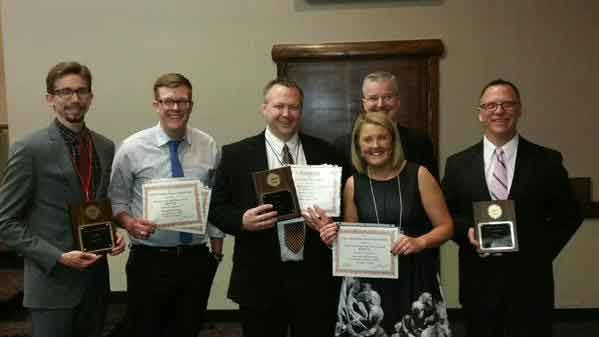 From left: KWWL chief photographer Sean O'Neal, reporter Michael Crowe, assistant news director Eric Page, reporter Nikki Newbrough, morning anchor Jerry Gallagher and news director Shane Moreland.