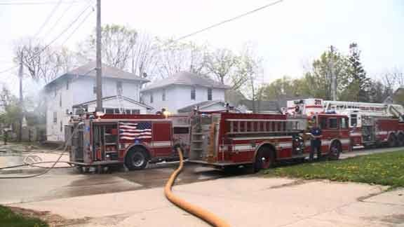 Fire crews work on a Waterloo fire Friday, May 1, 2015. (Sean O'Neal, KWWL Chief Photographer)
