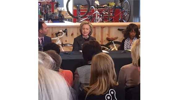 Democratic candidate Hillary Clinton speaks to a crowd at Bike Tech in Cedar Falls on Tuesday, May 19, 2015. (Lauren Moss, KWWL)