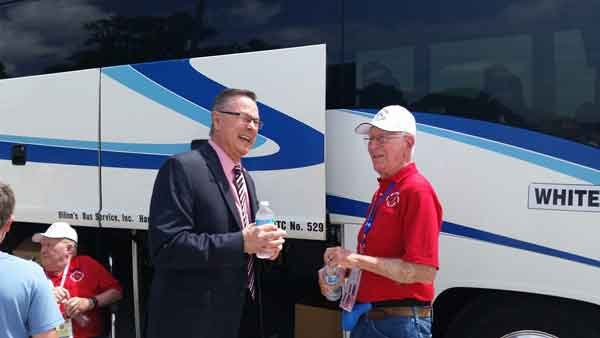 Rep. Rod Blum with a veteran from Tuesday's Honor Flight.