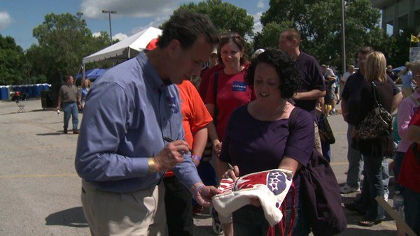 Rick Santorum signs Naomi Leinen's purse at the 2011 Iowa Straw Poll. Michelle Bachmann won that contest, but Santorum won the 2012 Iowa Caucus.