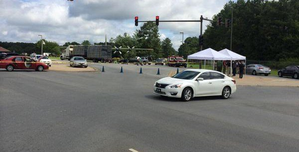 The scene outside the front gate at Little Rock Air Force Base in Arkansas on Monday, June 15, 2015. (Drew Petrimoulx, KARK)
