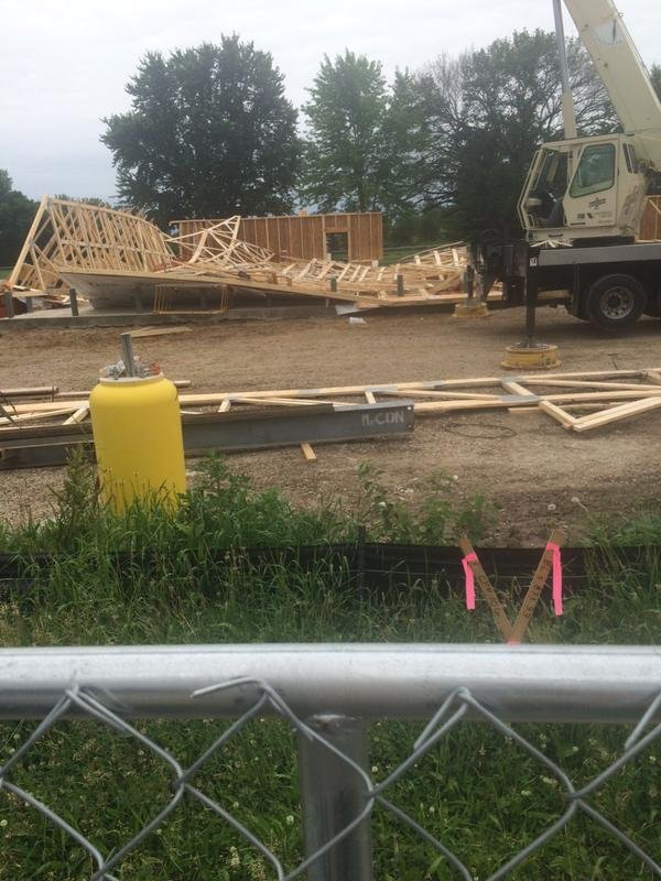 Officials on the scene of a Kwik Star building collapse June 24, 2015, in Evansdale. (Olivia Mancino, KWWL)