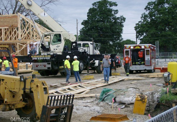 Officials on the scene of a Kwik Star building collapse June 24, 2015, in Evansdale. (Courtesy of viewer Gerald Rubino)