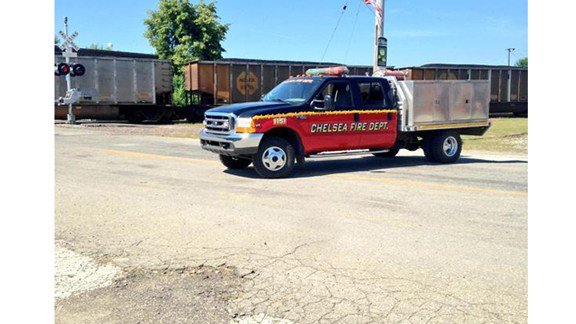 A train stopped in the middle of Chelsea after an accident on the tracks Thursday, July 23. (Kristin Rogers, KWWL)