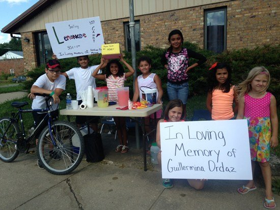 Nieces, nephews and other family friends set up a lemonade stand in memory of their aunt just hours after she was killed walking along the railroad tracks in Chelsea on Thursday, July 23. (Kristin Rogers, KWWL)