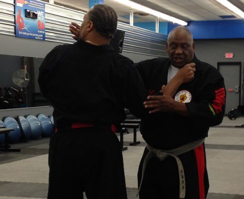 Sijo (founder) James Culpepper, right, demonstrates self-defense techniques rooted in martial arts on his student, Great Grand Master Dwight Foster of Rockford, Ill., on Thursday, Aug. 6, 2015. (Amie Steffeneicher, KWWL)
