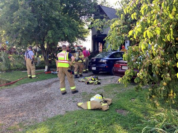 Crews put out a fire at a home in Center Point on Wednesday, Aug. 12, 2015. (Justin Andrews, KWWL)