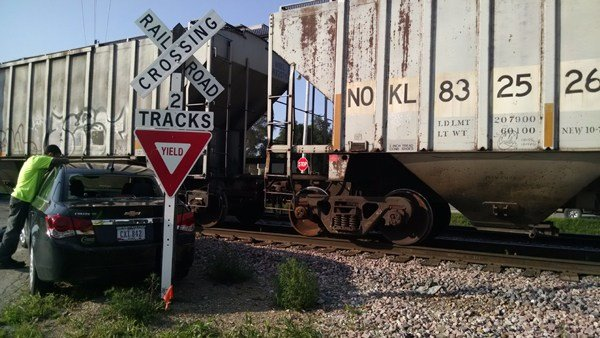 Damage to a car after it was hit by a train in Waterloo Thursday, Aug. 13, 2015. (Courtesy Derrick Kacher)