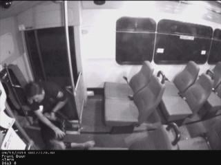Surveillance video shows Officer Ryan Clark slamming Korey Monahan into bus steps after she threatened to punch him.