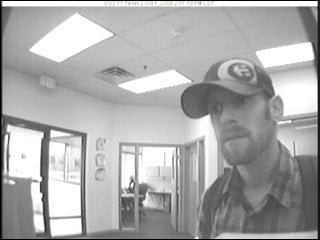 Security camera picture of the suspect in a bank robbery in North Liberty
