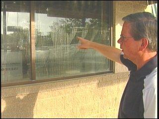 Joe McLaughlin shows how high the water got during the flood.