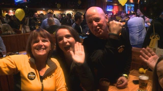 Fans cheer on the Hawkeyes in Indianapolis ahead of the Big Ten Championship.  Hawkeye fans are looking for another strong showing at the Rose Bowl.