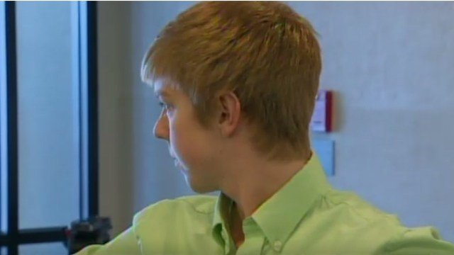 Ethan Couch, turns away from cameras.