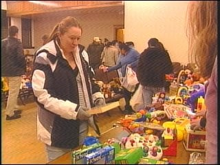 Tiffany Upton picking out toys for her daughter.