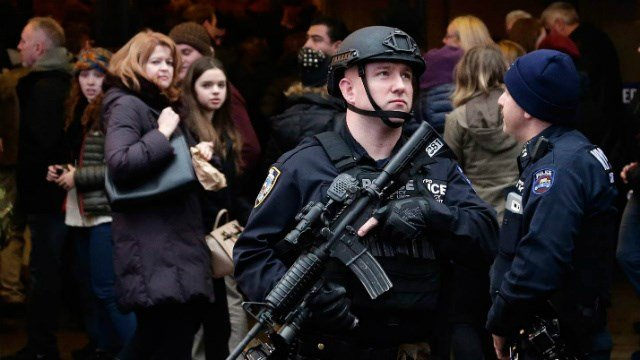 A member of the New York City Police Department's Hercules team patrols in Time Square the day before New Year's Eve on Wednesday