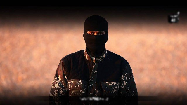 A screengrab of the ISIS propaganda video featuring a masked man with what sounded like a British accent.
