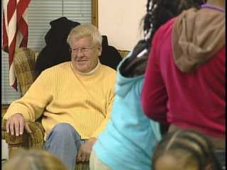 Ken Budke watches as kids enjoy the program he helped create at the Salvation Army