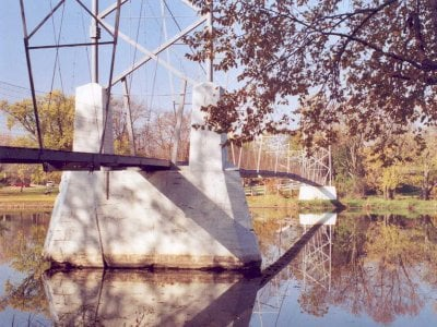 Photos taken October 2005 by Jason and Birgit Smith, floods washed away the bridge in June of 2008