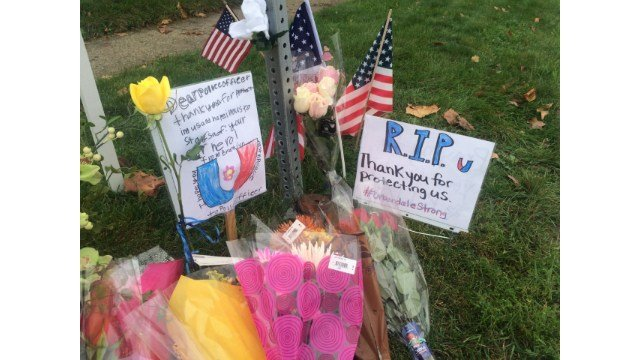 Memorial outside of Urbandale High School where Officer Martin was killed.