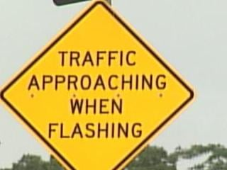 The warning signs installed in Dyersville are the first ever in Iowa.
