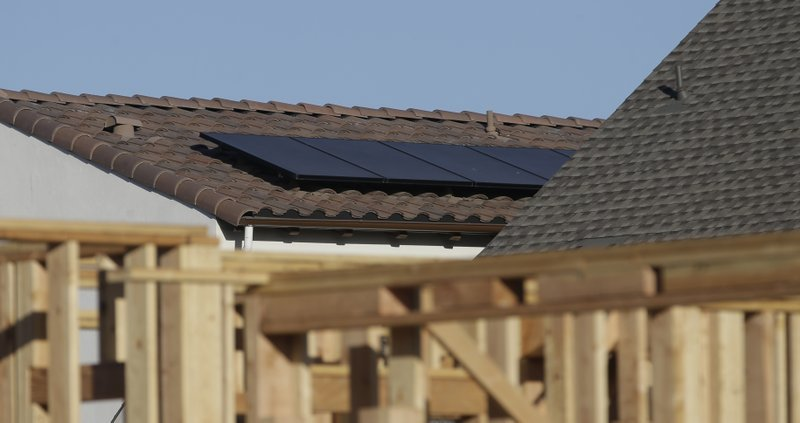 (AP Photo/Rich Pedroncelli) In this photo taken Monday, May 7, 2018, solar panels are seen on the rooftop on a home in a new housing project in Sacramento, Calif. The California Energy Commission will take up a proposal, Wednesday, May 9, 2018 to...