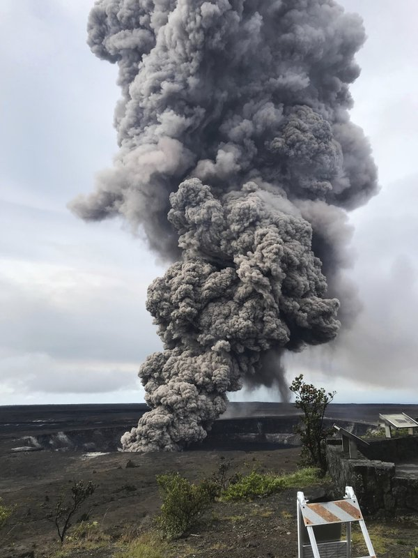 In this Wednesday, May 9, 2018 photo, an ash column rises from the crater at the summit of Kilauea volcano at Volcanoes National Park, Hawaii. Scientists said Wednesday the risks of an explosive summit eruption will rise in coming weeks as magma drains do