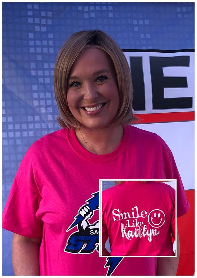 "KWWL's Abby Turpin wears a ""Smile like Kaitlyn"" shirt.  Many at KWWL were deeply touched by Kaitlyn's story."