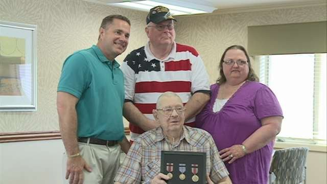 Congressman Bruce Braley presented Dean with the medals during a small ceremony at Ravenwood Nursing Home in Waterloo.