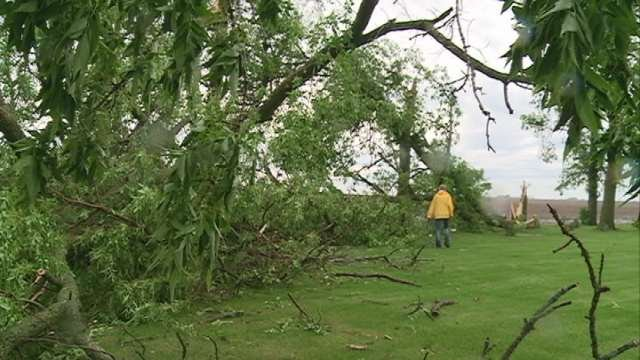 Mary Schipper surveys the damage to her property in rural Greene after Wednesday's storm.
