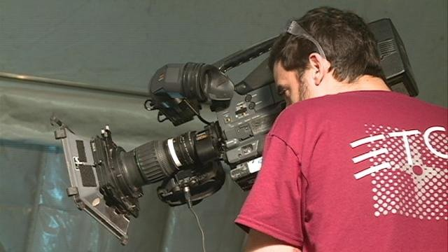 """A """"How It's Made"""" crew member shoots video Thursday at ClearSpan in Dyersville"""