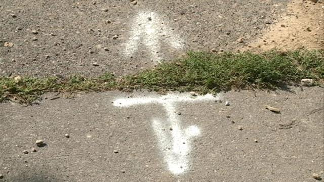 A portion of sidewalk in Dubuque is marked for repairs